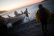Fishermen of Pueblo Viejo de San Dionisio, a small isolated fishing community get off a boat to begin fishing in Isthmus of Tehuantapec in the early hours of the morning. ..The Isthmus of Tehuantapec, long a center for indigenous land ownership, is now embroiled in a land dispute over wind farm land.