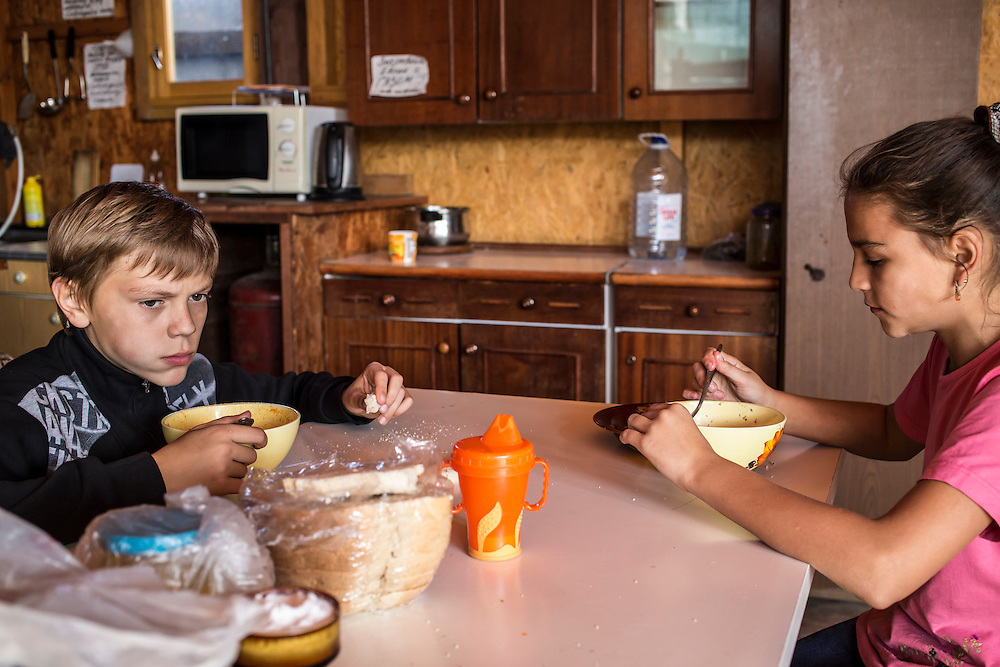 Teenagers, among a group of internally displaced people who fled the besieged city of Donetsk, eat soup in the small seaside resort that has become their home on Tuesday, October 14, 2014 in Berdyansk, Ukraine. Photo by Brendan Hoffman, Freelance
