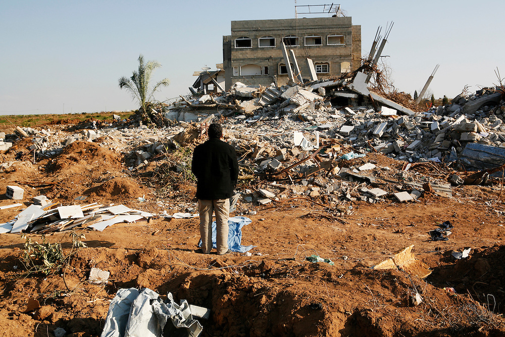 In the midst of their ongoing siege of the Gaza Strip, on 27 December Israel launched attacks by air, land and sea against the 1.5 million Palestinians of Gaza. The attacks, said to put an end to homemade rocket fire from armed groups in Gaza into Israel, left more than 1,300 Palestinians killed, the majority of whom were civilians including almost 450 children. Thousands of homes and businesses were also destroyed throughout the territory.///A man prays in front of his home, which was destroyed by Israeli air strikes in Beit Hanoun in the northern Gaza Strip.