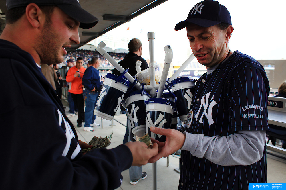 A fan buys popcorn in a Yankees tub during the New York Yankees V Detroit Tigers Baseball game at Yankee Stadium, The Bronx, New York. 28th April 2012. Photo Tim Clayton