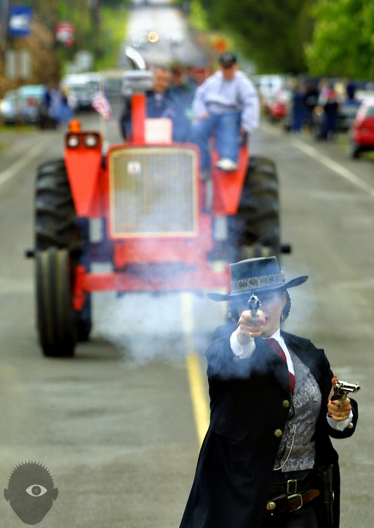 Gunslinger and professional pistol shooter Robin Bloom (aka Rocky Meadows) walks the parade route at the 68th Annual Linn County Lamb and Wool Fair. The Scio, Oregon, event features not only a themed parade but many lamb-related events and the residents work to keep the traditions alive.