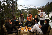 Richard Landry, second from left, relaxes with family and friends on the deck of his self-designed Mammoth Lakes, CA vacation home, January 9, 2010.