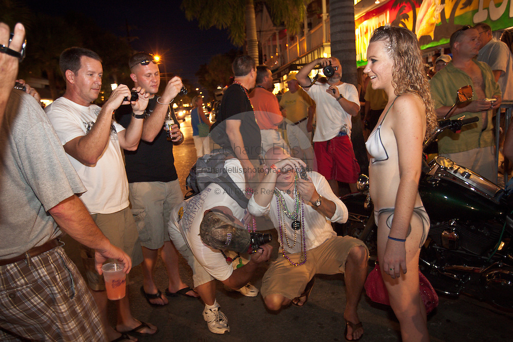 A topless reveler in only body paint during Fantasy Fest halloween parade in Key West, Florida.