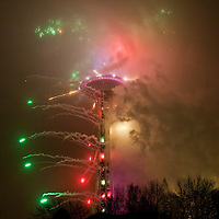 WA09484-00...WASHINGTON - The Seattle Center Space Needle with fireworks at  New Years celebration, 2013-2014