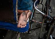 Sleeping pedi-rickshaw driver's feet.  Malate, Manila, Philippines.