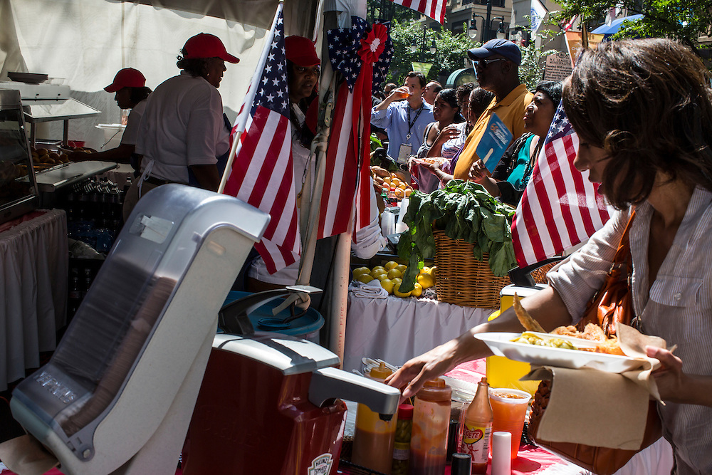 People buy food from vendors at Carolinafest, a public street festival held ahead of the Democratic National Convention, on Monday, September 3, 2012 in Charlotte, NC.