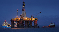 Oil Rig Being Towed at Night In Norway