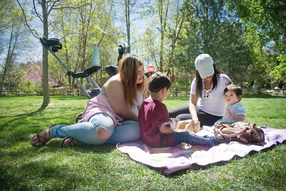 mkb040617b/metro/Marla Brose --  Brenda Ibarra, right, picnics at ABQ BioPark's Botanic Garden with her children, ten-month-old Briella Caldera and Jayren Caldera, 5, and her sister Valeria Ibarra, left, Thursday, April 6, 2017, in Albuquerque, N.M.(Marla Brose/Albuquerque Journal)