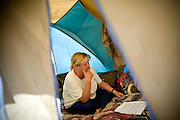 RENO, NV - OCTOBER 6:  Mary Jackson and her husband discuss housing options in a tent city for the homeless in downtown Reno, Nevada October 6, 2008. Jackson works odd jobs and her husband, a veteran, works 18 hours per week, but they're unable to make enough money to afford housing. The City of Reno set up the tent city when existing shelters became overcrowded as Nevada struggles with one of the highest unemployment rates in the country. (Photo by Max Whittaker/Getty Images)