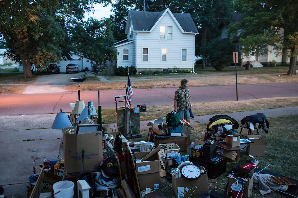 Lloyd Heslop looks at his belongings scattered in the yard after being evicted from his apartment on Monday, July 16, 2012 in Webster City, IA.
