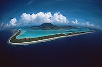 Puffy clouds fill the sky over Bora Bora Island, Society Islands, French Polynesia.  June 2002.