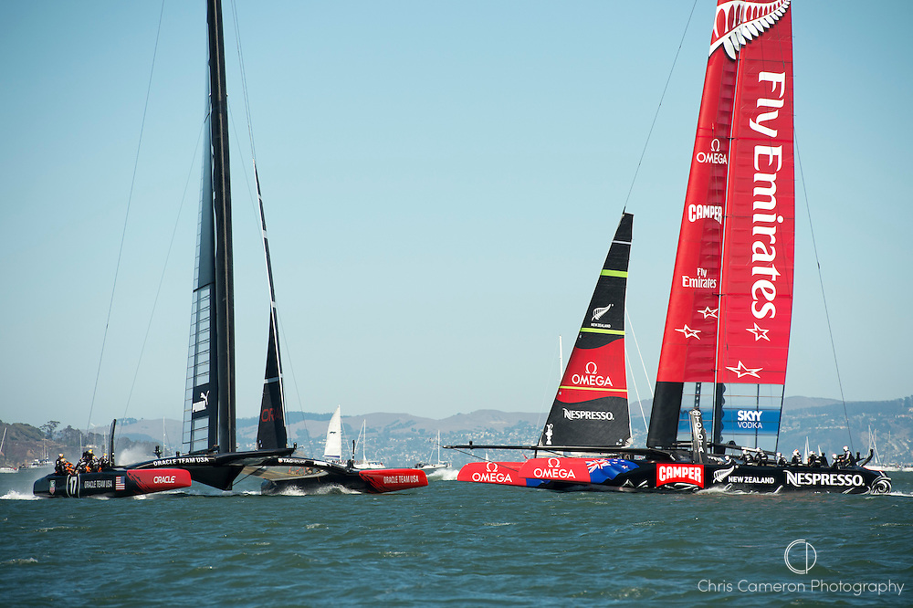 Emirates Team New Zealand ducks Oracle Team USA just before the top mark in race ten on day six of America's Cup 34. 15/9/2013