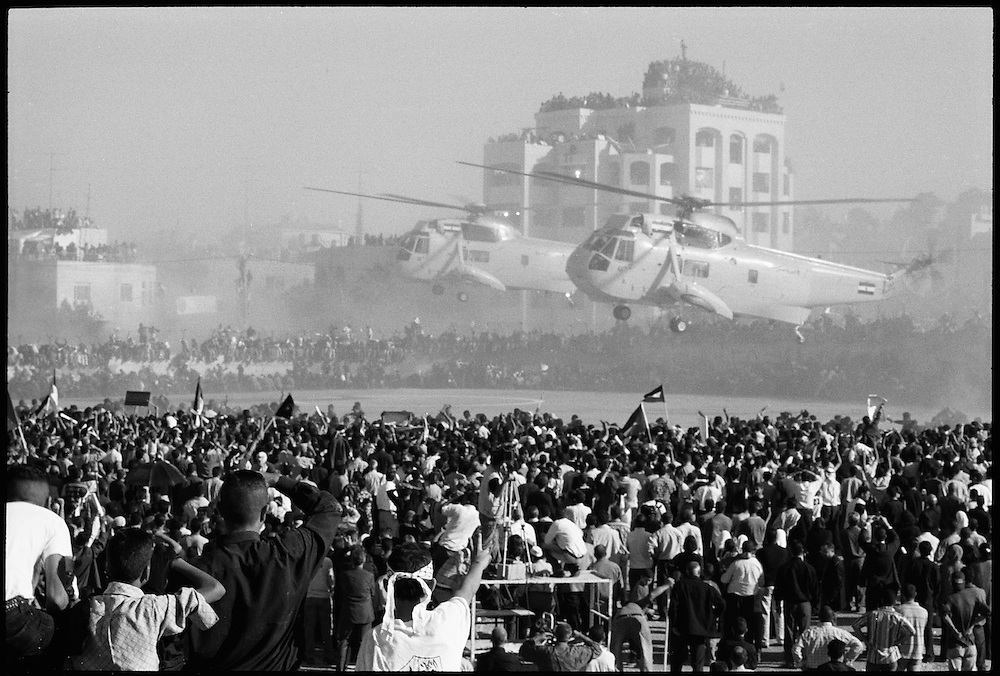 Yasser Arafat's body is flown in on Egyptian helicopters after a large service in Cairo. Thousands of Palestinians came out to take part in the burial service in the Al Muqataa compound in Ramallah.