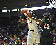 Ole Miss's Murphy Holloway (31) grabs a rebound against Mississippi Valley State's Montrell Holley (42) in Oxford, Miss. on Friday, November 9, 2012.