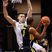 WEST LAFAYETTE, IN - JANUARY 27: Donnie Hale #15 of the Purdue Boilermakers defends as Melsahn Basabe #1 of the Iowa Hawkeyes looks to shoot at Mackey Arena on January 27, 2013 in West Lafayette, Indiana. Purdue defeated Iowa 65-62 in overtime. (Photo by Michael Hickey/Getty Images) *** Local Caption *** Donnie Hale; Melsahn Basabe