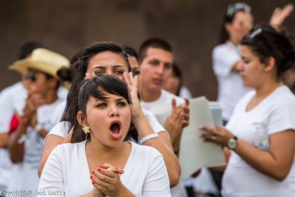 23 APRIL 2012 - PHOENIX, AZ:  Students cheer a speaker  at the Arizona State Capitol Monday. About 200 high school students from across the Phoenix metropolitan area rallied at the Arizona state capitol in Phoenix Monday to show their opposition to Arizona's tough anti-immigration law, SB 1070. April 23 is the 2nd anniversary of the law's signing. The US Supreme Court is taking up the law during a hearing Wednesday, April 25 in Washington DC.        PHOTO BY JACK KURTZ