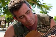 Man playing guitar in Bocas, Holguin, Cuba.