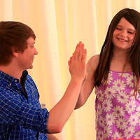 Actor Calum Worthy, left, 'high fives' Inez Pirko, 10, Sunday at the North Carolina Azalea Festival. (Jason A. Frizzelle)