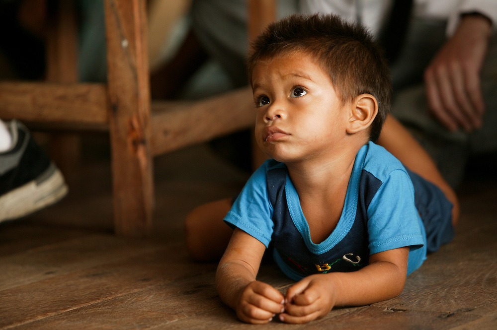 Nov. 13, 2003. A child listens during a community meeting at Ipiranga on the Guajara River in Para State, Brazil to talk about forming an extractive reserve of forest land with Greenpeace.