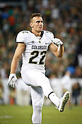 SHOT 9/19/15 7:00:19 PM - Colorado's Nelson Spruce #22 stretches on the field after halftime against Colorado State during the Rocky Mountain Showdown at Sports Authority Field at Mile High in Denver, Co. Colorado won the game 27-24 in overtime. (Photo by Marc Piscotty / © 2015)