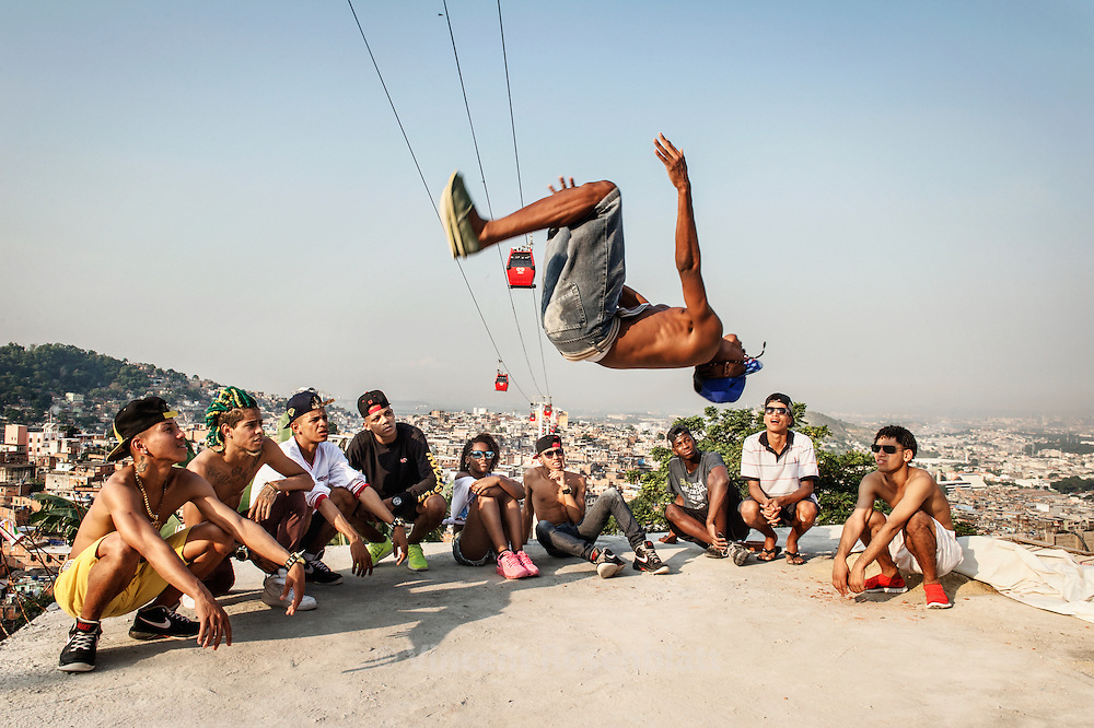 """Ronald """"Sheick"""", one of the best """"passinho"""" dancer of Rio de Janeiro. Rehearsal of the show  """"Na Batalha"""" on a rooftop of the Complexo do Alemão favelas. Elite dancers of the """"Passinho"""" (little step) the newest dance fever that came out the Baile Funk culture."""