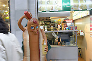 A hotdog statue stands outside a small restaurant/shop near Taksim, in Istanbul.