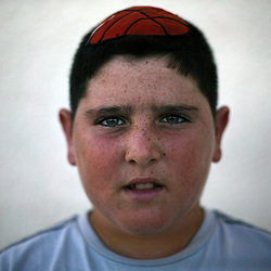 """Yair Hazout, 12, resident of the Gush Katif settlements is seen in Gaza, Palestinian Territories, Nov. 11, 2004. When asked his thoughts about leaving the settlements Hazout responded, """"It is very bad for Sharon to want to separate us. I have friends here and a home."""" Israel's parliament recently supported compensation payments for Jewish settlers leaving the Gaza Strip, in a vital vote for Prime Minister Ariel Sharon's plan to evacuate the occupied territory."""