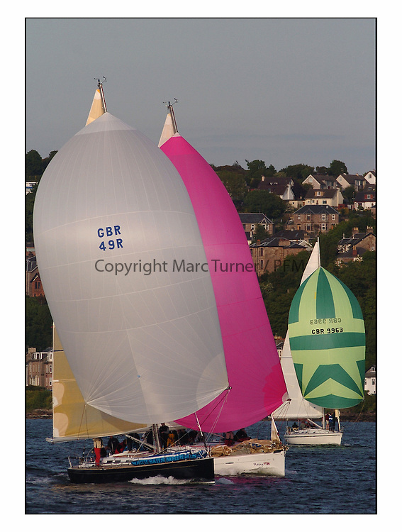 Racing at the Bell Lawrie Yachting Series in Tarbert Loch Fyne ..The start from Gourock overnight to Tarbert Loch Fyne...Grand Soliel 45, GBR49R Blue Magic  beneath Playing Ftse..