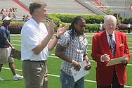 Fomer Rebel Dexter McCluster was presented a certificate for being named first team-All-American by the All-American Football Foundation by Jimmie McDowell (right) during halftime of Mississippi's Grove Bowl in Oxford, Miss. on Saturday, April 17, 2010. Athletic director Pete Boone looks on.