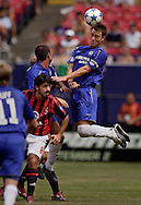 Chelsea's John Terry heads a ball away from AC Milan's Genaro Gattuso during a match.   (Photo by Robert Falcetti). .
