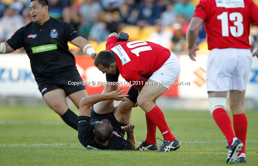 Hugh McGahon gets speared by Craig Smith of the Red Legends. Australia and New Zealand Legends of League Christchurch Earthquake Appeal Match, Mt Smart Stadium, Auckland, New Zealand, Thursday 10 March 2011. Photo: Simon Watts / photosport.co.nz
