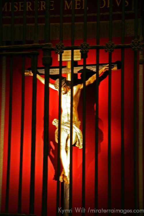 Europe, Spain, Seville. The Cathedral of Seville, Cathedral de Sevilla. Christ on red.