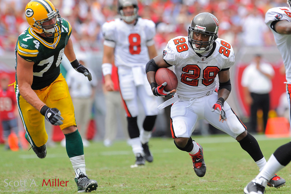 Tampa, Florida, Sept. 28, 2008: Tampa Bay Buccaneers running back Warrick Dunn (28) out runs Green Bay Packers defensive end Aaron Kampman (74) during their game at Raymond James Stadium....©2008 Scott A. Miller