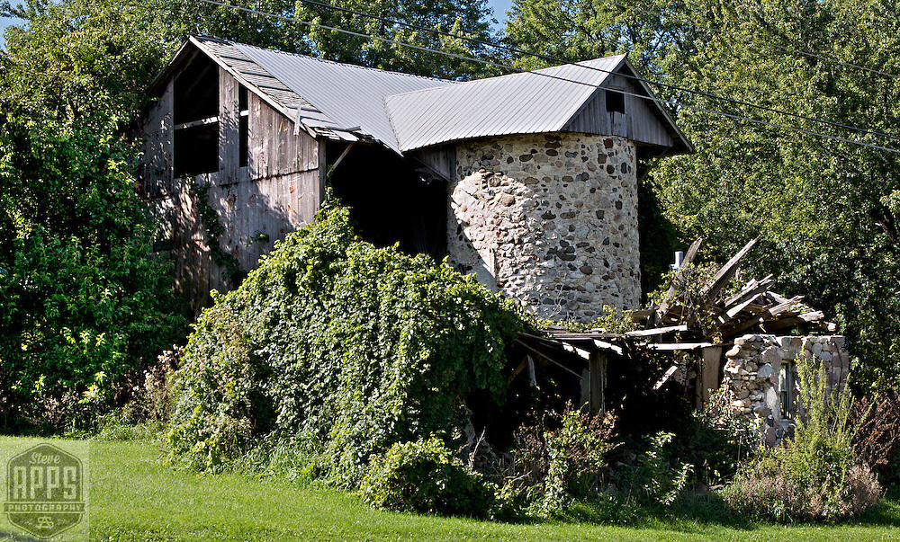 A collection of Barns that still can be seen while traveling the countryside in  the beautiful State of Wisconsin.<br /> Waukesha County- Stone silo with vines- County G &amp; Highway 18. Barns from around the State of Wisconsin.