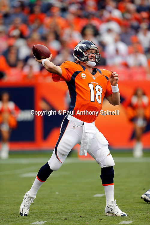 Denver Broncos quarterback Peyton Manning (18) throws a pass during the NFL week 4 football game against the Oakland Raiders on Sunday, Sept. 30, 2012 in Denver. The Broncos won the game 37-6. ©Paul Anthony Spinelli