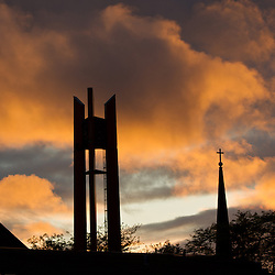 Clock tower and the steeple of the Karen Hille Phillips Performing Arts Center against a sunset at PLU on Wednesday, May 23, 2012(Photo/John Froschauer)