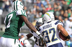 Oct 23, 2011; East Rutherford, NJ, USA; San Diego Chargers safety Eric Weddle (32) runs with the ball after intercepting a pass from New York Jets quarterback Mark Sanchez (6) during the first half at MetLife Stadium.