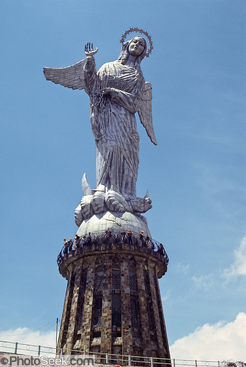 "La Virgen de Quito, on Panecillo hill, is an aluminum statue of the winged virgin (45 meters tall), inspired and enlarged from Bernardo de Lagarda's 1734 sculpture on display on the main altar in San Francisco Church, Quito, Ecuador, South America. This madonna was created in 1976 by Spanish artist Agustín de la Herrán Matorras. The virgin stands on top of a globe and is stepping on a snake. The wings are unusual in the tradition of madonna icons. Seen to the south of downtown Quito, the Panecillo hill looks like a ""small bread roll"" (its Spanish translation) and stands at about 3000m (9840 feet). Before the Spanish arrived, the Incas worship the sun on Shungoloma, or Hill of the Heart (present-day Panecillo).  Later, from 1812 to 1815, the Spanish constructed a fortress on the hill to control people below. Visit from Old Town via inexpensive taxi. See panoramic 360° views of Quito from here, best early in the morning (around 10:00 am), before the clouds form on nearby mountains. On a clear day, see Cotopaxi in the distance.  UNESCO honored City of Quito as a World Heritage Site in 1978. Quito was founded in 1534 on the ruins of an Inca city. Despite the 1917 earthquake, the city has the best-preserved, least altered historic center in Latin America."