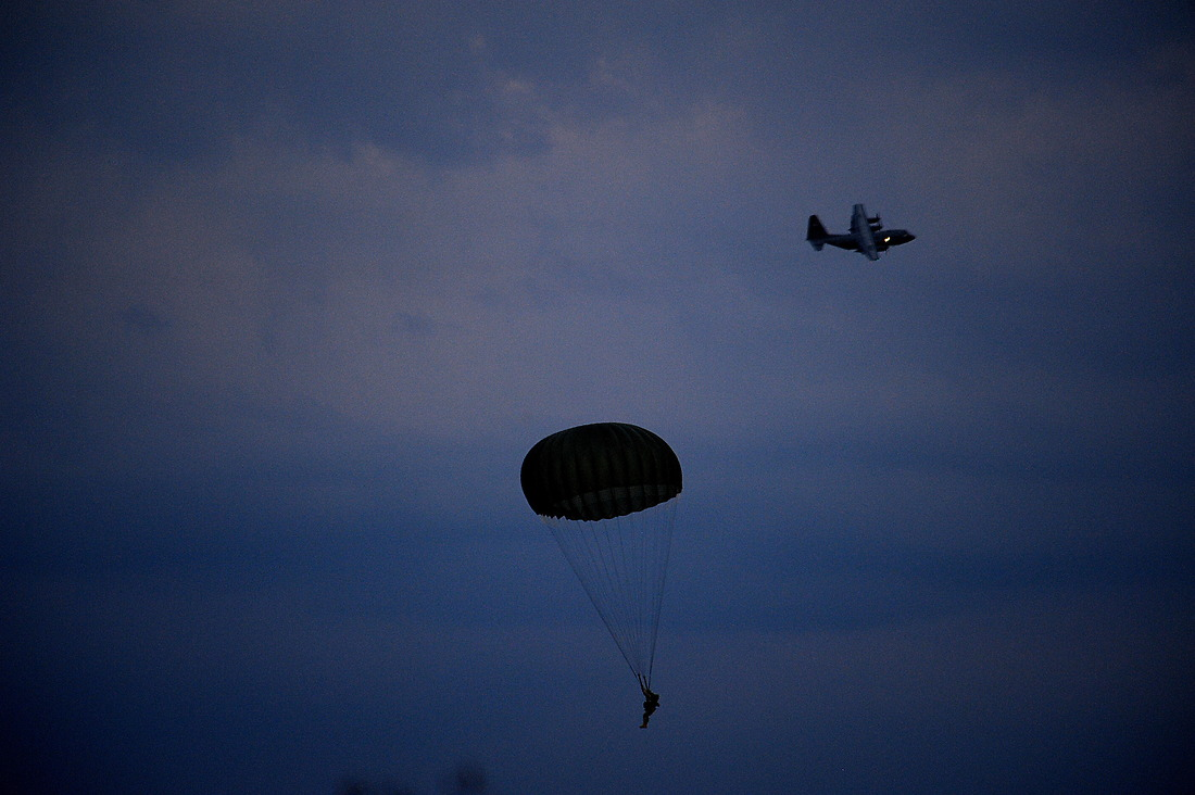 A U.S. Army Soldier from the 82nd Airborne Division, Ft. Bragg, North Carolina, parachutes down on to drop zone Luzon after jumping from a C-130 Hercules during Airborne Operations on Sept. 12, 2010, at Ft. Bragg, North Carolina. — © Master Sgt. Jeremy Lock/