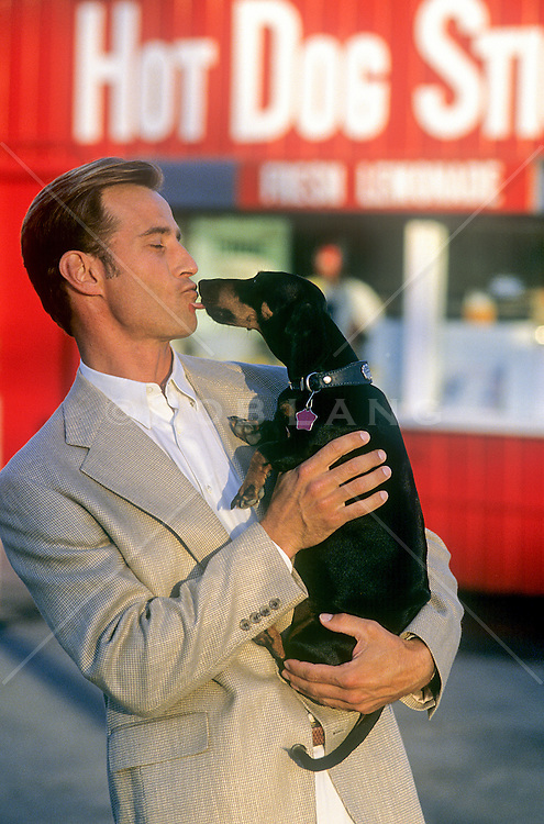 man enjoying time with a dog outdoors