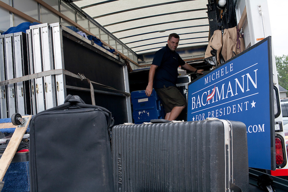 A worker loads equipment into a van following a campaign appearance by Republican presidential hopeful Michele Bachmann on Friday, August 5, 2011 in Newton, IA.