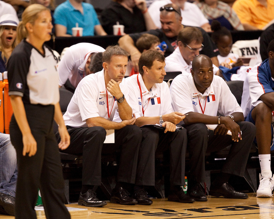 GJR515 -20100813- Toronto, Ontario,Canada<br /> France's coaching staff, head coach Vincent Collet, left, assistant coaches Jaques Commeres, centre, and Ruddy Nelhomme watch as their team was defeated by Canada 85-63 in their second meeting at the 2010 Jack Donohue International Classic tournament in Toronto, Canada August 13, 2010. <br /> AFP PHOTO/Geoff Robins