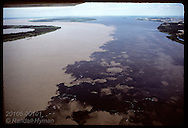 Aerial: Negro (on right) & Amazon (Solimoes) Rivers join @ Manaus (back) but don't mix for miles. Brazil
