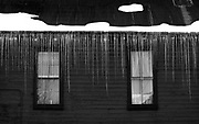"""SHOT 1/10/09 6:03:55 PM - Icicles hang from a roofline on the Forest Queen hotel in Crested Butte, Co. This 7-guestroom hotel is on Elk Street in historic Crested Butte, a block from the Crested Butte Mountain Theatre. Crested Butte is a Home Rule Municipality in Gunnison County, Colorado, United States. A former coal mining town now called """"the last great Colorado ski town"""", Crested Butte is a destination for skiing, mountain biking, and a variety of other outdoor activities. The population was 1,529 at the 2000 census. The Colorado General Assembly has designated Crested Butte the wildflower capital of Colorado. The primary winter activity in Crested Butte is skiing or snowboarding at nearby Crested Butte Mountain Resort in Mount Crested Butte, Colorado. Backcountry skiing in the surrounding mountains is some of the best in Colorado. The mountain, Crested Butte, rises to 12,162 feet (3,700 m) above sea level..(Photo by Marc Piscotty / © 2009)"""