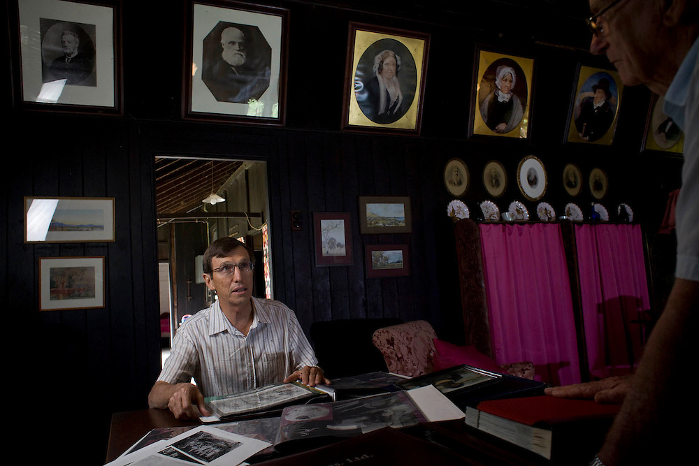 """Repatriation of aboriginal remains from Europe and the U.S. to back to Australia story..Bruce Foster son of Alison Archer on the """"Archer Farm family property in the dinning room lounge room with the portraits of the family on the wall."""