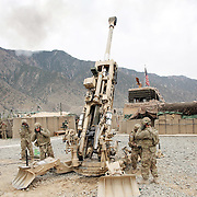 Soldiers load a 155 mm howitzer to shoot at Taliban forces  Forward Operating Base Bostick, Kunar Province of Eastern Afghanistan.