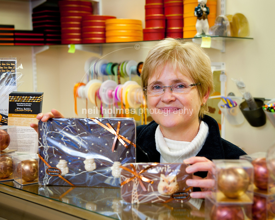 Sally Hawkes shows some of her Christmas chocolate, at her shop White Rabbit Chocolate