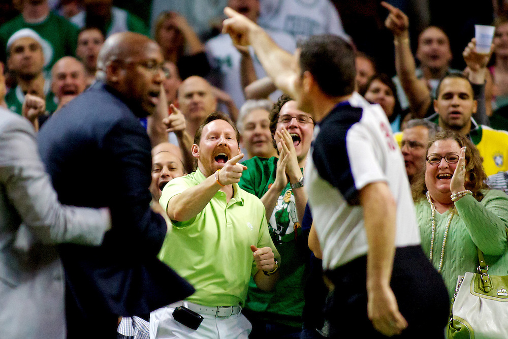 4/4/2010 -- BOSTON -- Boston Celtics fans heckle Cleveland Cavaliers head coach Mike Brown as he is ejected by referee Monty McCutchen at the TD Garden. The Celtics won, 117-113.