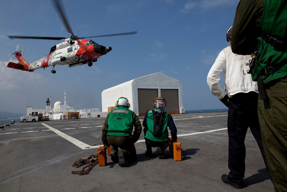A U.S. Coast Guard helicopter lands on board the USNS Comfort, a naval hospital ship, with Haitian earthquake victims on board on Wednesday, January 20, 2010 in Port-Au-Prince, Haiti. The Comfort deployed from Baltimore, bringing nearly a thousand medical personnel to care for victims of Haiti's recent earthquake.