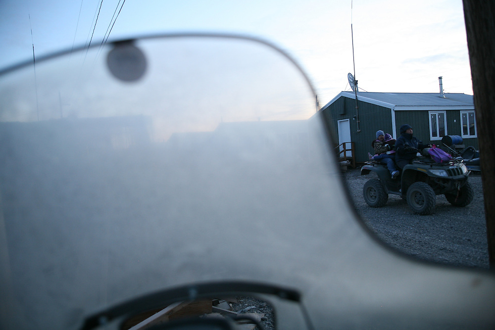 Family driving by in Noatak, Alaska. 2009